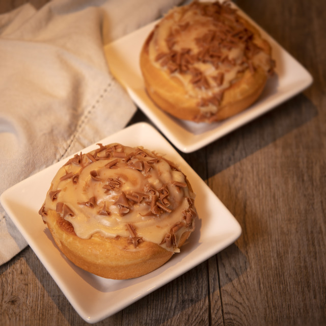 """""""sweet buns with cinnamon and toffee icing on a wooden table"""" stock image"""