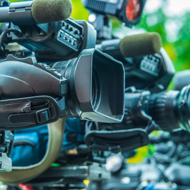 """""""Professional tv cameras on tripods recording social event"""" stock image"""