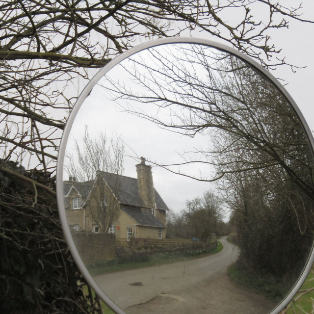 """Mirror reflection of Cotswold building"" stock image"