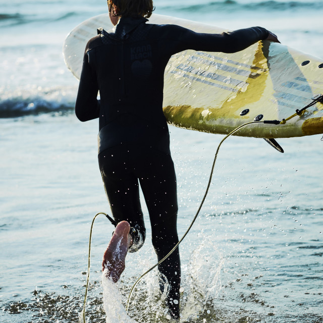 """A young boy surfer"" stock image"