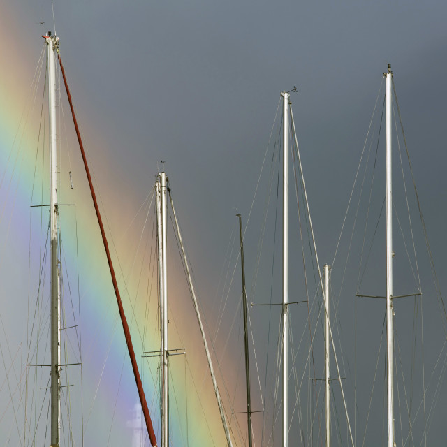 """Masts And A Rainbow"" stock image"