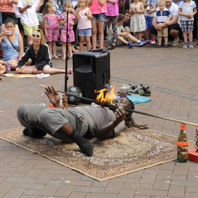 """John the Acrobat limbo dancing at Sidmouth Folk Festival"" stock image"