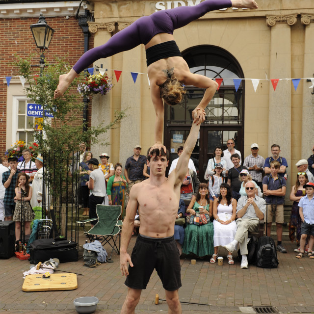 """""""Acrobats Rhiannon and Dan at Sidmouth Folk Festival"""" stock image"""