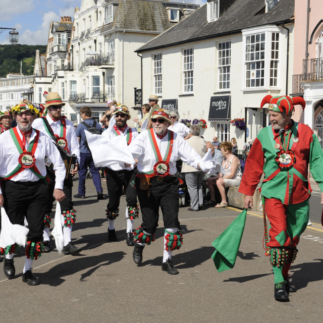 """Procession of Morris Dancers at Sidmouth Folk Festival"" stock image"