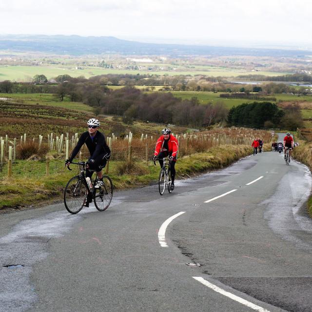 """Cyclist climbing Winter Hill"" stock image"