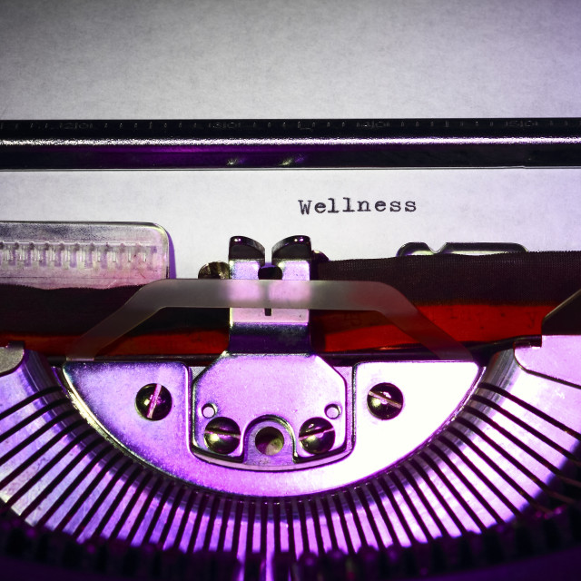 """Vintage typewriter with the word wellness printed on a letter"" stock image"