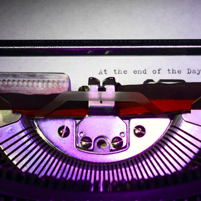 """Vintage typewriter with the phrase at the end of the day printed on a letter"" stock image"