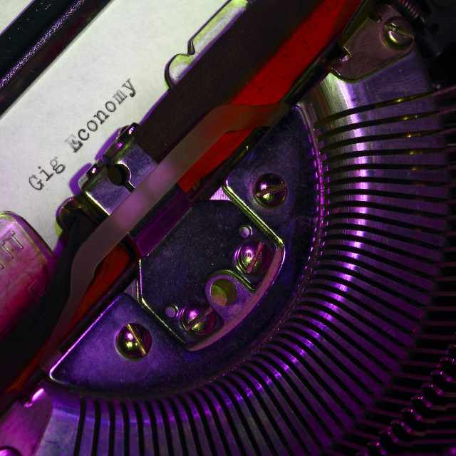 """""""Vintage typewriter with the words gig economy printed on a letter"""" stock image"""