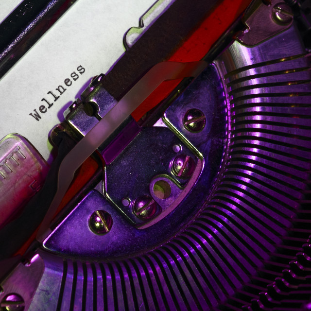 """""""Vintage typewriter with the word wellness printed on a letter"""" stock image"""