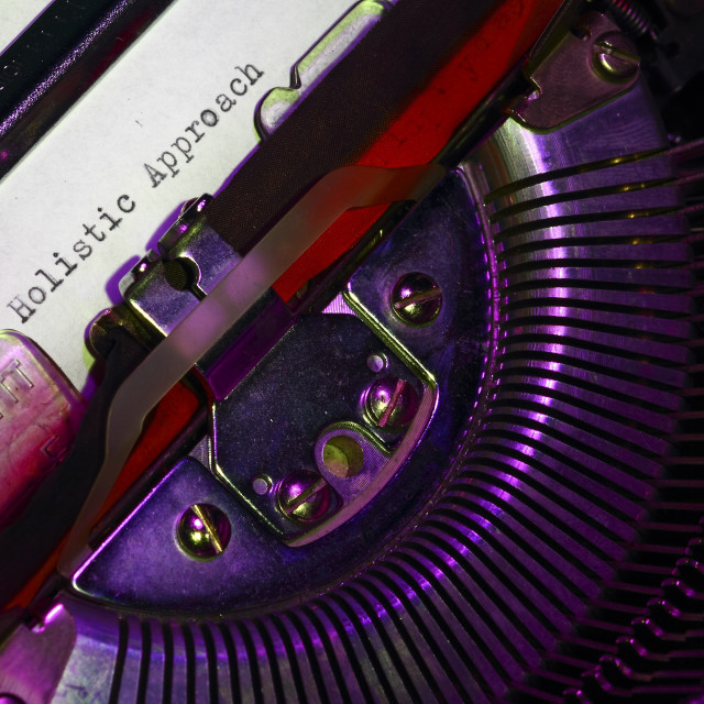 """""""Vintage typewriter with the phrase holistic approach printed on a letter"""" stock image"""