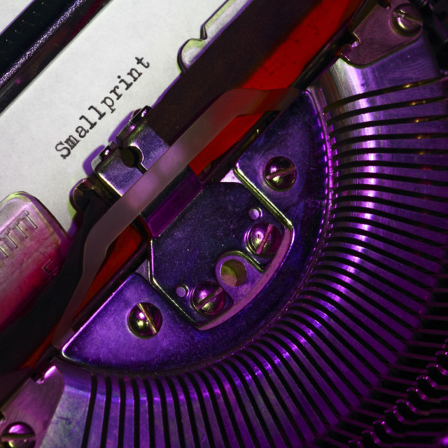 """""""Vintage typewriter with the words small print printed on a letter"""" stock image"""