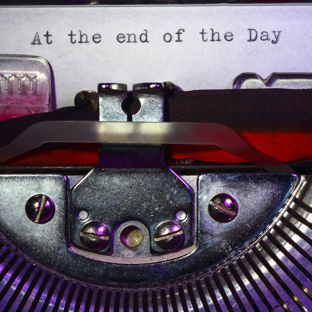 """""""Vintage typewriter with the phrase at the end of the day printed on a letter"""" stock image"""