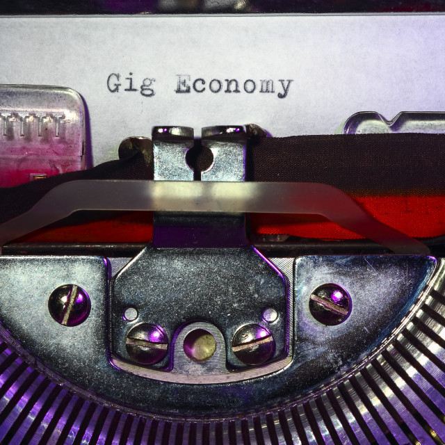 """Vintage typewriter with the words gig economy printed on a letter"" stock image"