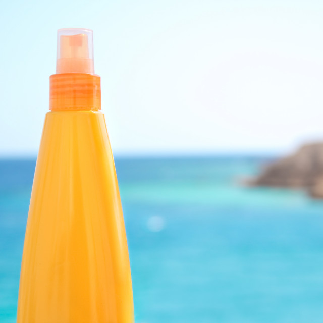 """suntan lotion on the beach - summertime, skincare and beauty sty"" stock image"