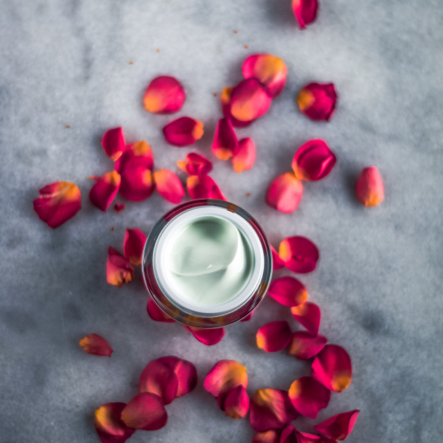 """""""luxe face cream and rose petals - cosmetics with flowers styled"""" stock image"""