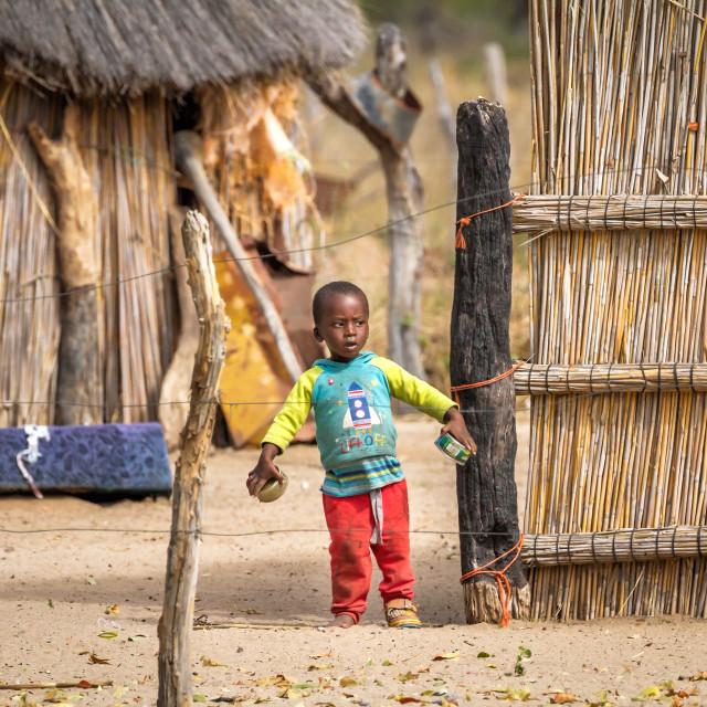 """""""Botswana village boy"""" stock image"""