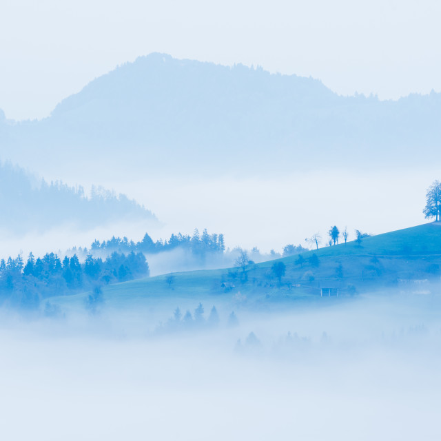 """""""High-key image of church surrounded by hills"""" stock image"""