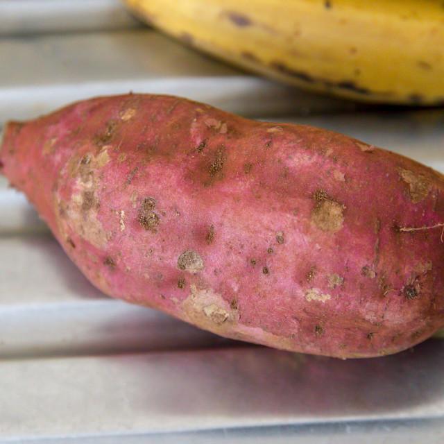 """Sweet potato and plantain on a metallic background"" stock image"