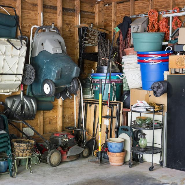 """""""Cluttered interior garage storage."""" stock image"""