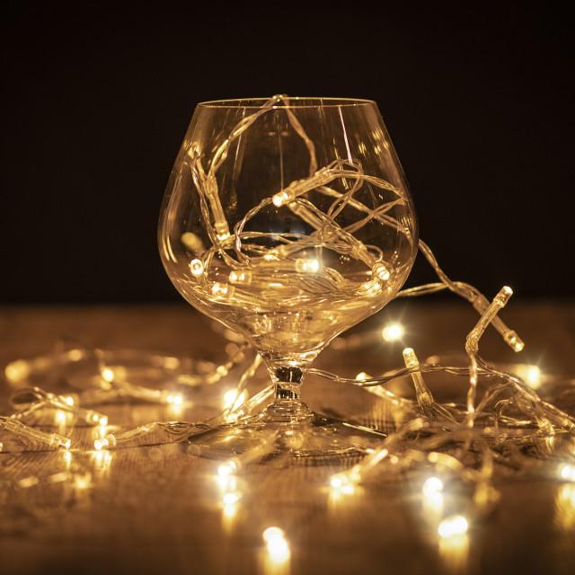 """brandy glass with fairy lights, celebration,"" stock image"