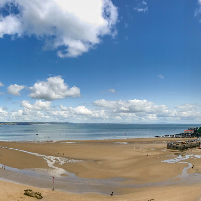 """""""Panoramic view of the sandy beach and harbour in Tenby, West Wales at low tide."""" stock image"""