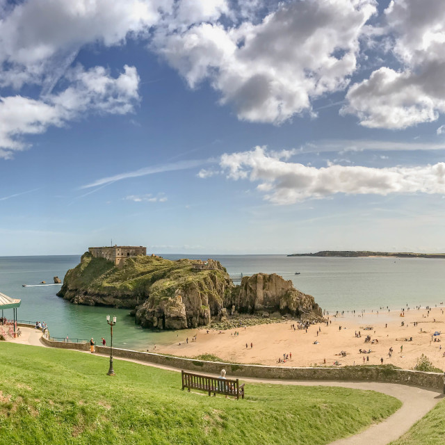 """""""The hill overlooking castle beach and St Catherine's Island in Tenby, West Wales."""" stock image"""