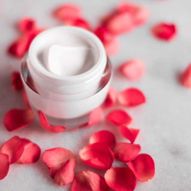 """""""luxe face cream and rose petals - cosmetics with flowers styled beauty concept"""" stock image"""