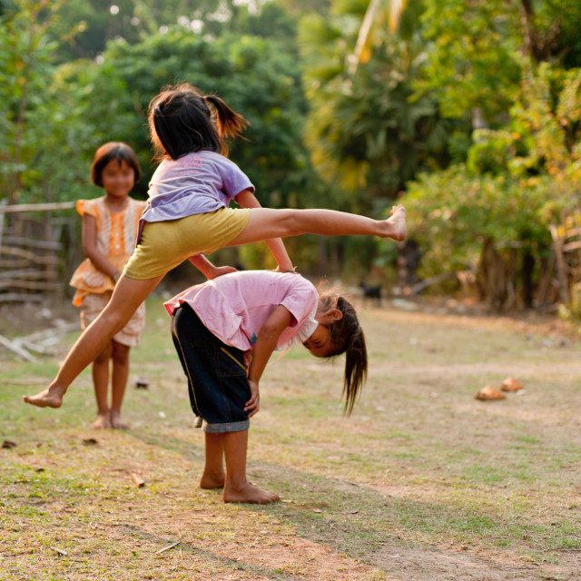 """""""Unidentified Children of Laos play and fun of kids in countrysid"""" stock image"""