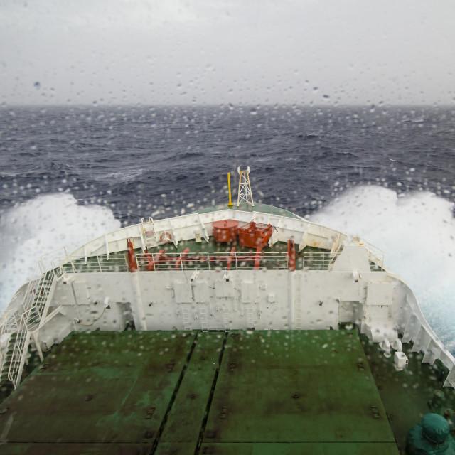 """Ship cruising in heavy seas"" stock image"