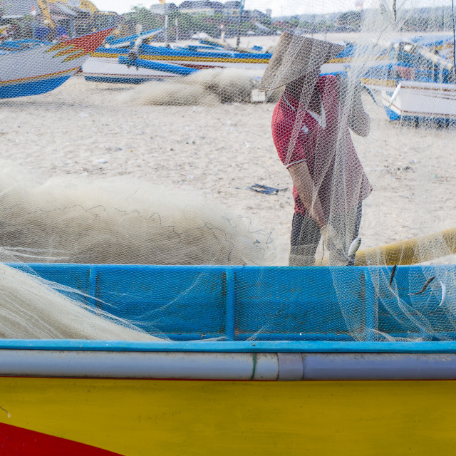 """""""Fisherman cleaning nets"""" stock image"""