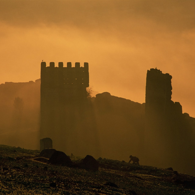 """""""Ramparts at sunrise and man laying hides, Fez, Morocco"""" stock image"""