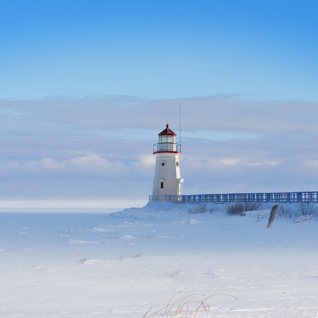 """""""Lighthouse in a calm and desolate winter landscape."""" stock image"""