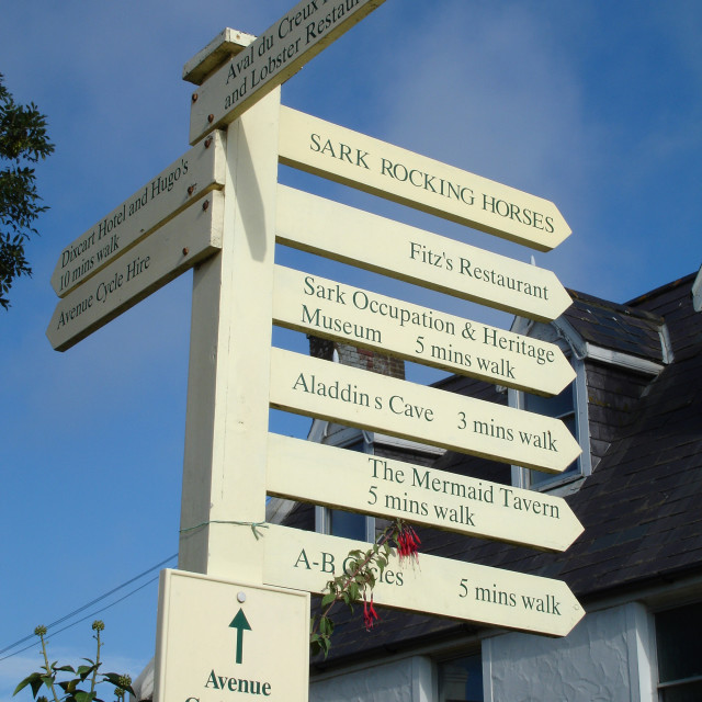 """""""Signpost on the Channel Island of Sark"""" stock image"""