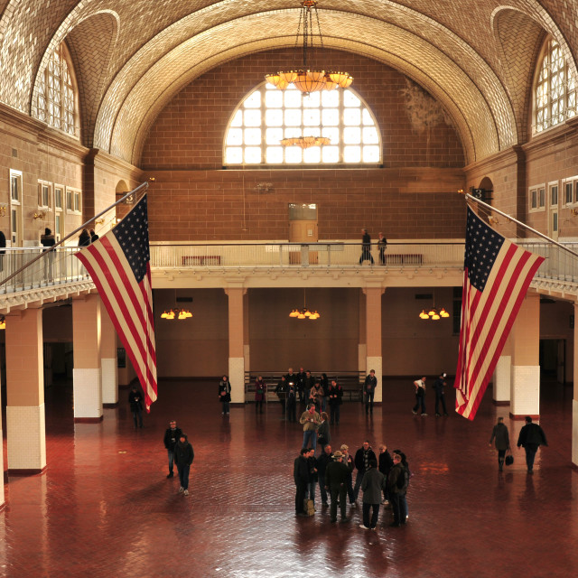 """Ellis Island National Monument interior and American Flags in New Jersey/New York, USA"" stock image"