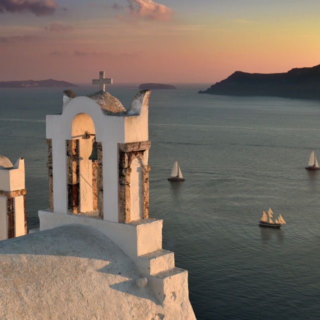 """Famous bell towers in the island of Santorini, Greece at sunset"" stock image"