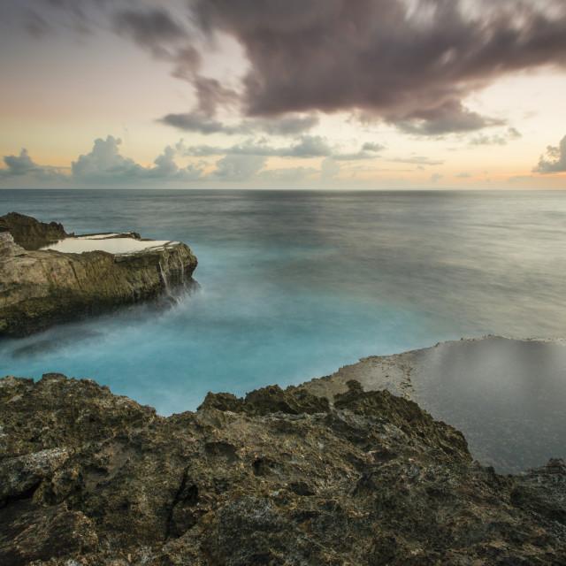 """Sunset at Devil's Tear cliffs of Nusa Lembongan, Bali"" stock image"