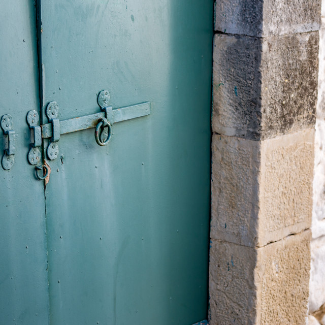 """""""Grungy closed blue metal door with slider lock"""" stock image"""
