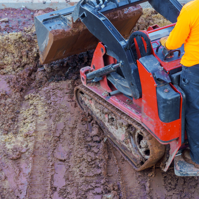 """""""Excavation works at the construction site. Bulldozer or a backhoe loader..."""" stock image"""