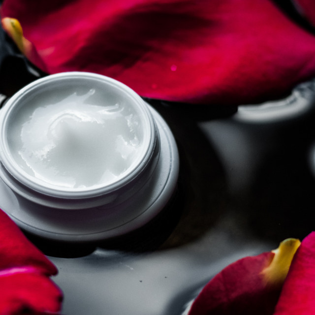 """""""beauty cream jar and flower petals - cosmetics with flowers styled concept"""" stock image"""