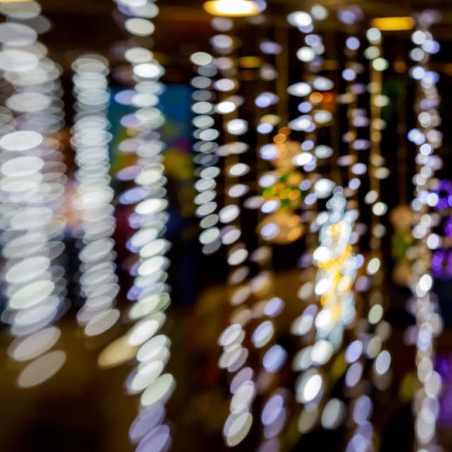 """""""Abstract blue bokeh texture on black background"""" stock image"""