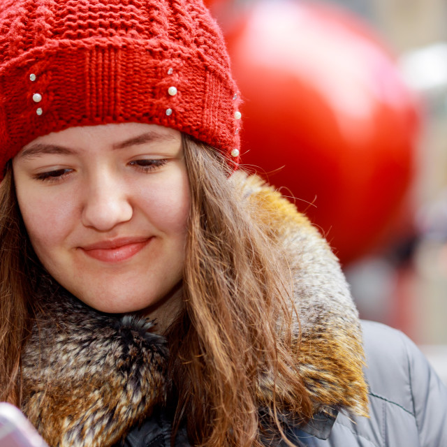 """""""Outdoor portrait of beautiful young lovely girl using mobile phone"""" stock image"""