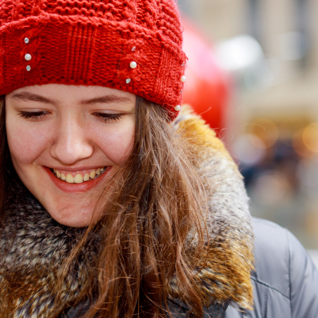 """""""Close up portrait of a beautiful smiling girl with brown hair wearing a hat"""" stock image"""