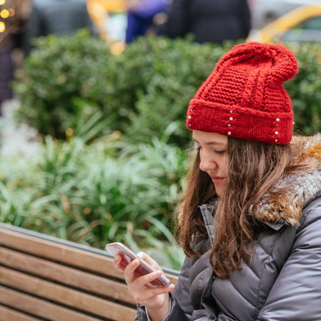 """""""Young pretty girl using her Mobile Phone in the street, light Background"""" stock image"""
