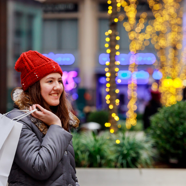 """""""Young girl at the street with shopping bags colorful lights bokeh"""" stock image"""