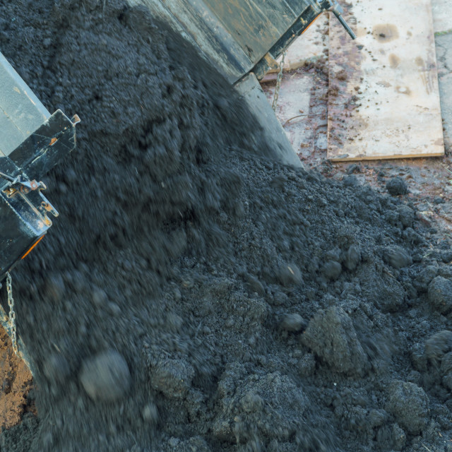 """""""Earthworks with truck dumping and tipping raw earth soil. Tip truck preparing..."""" stock image"""