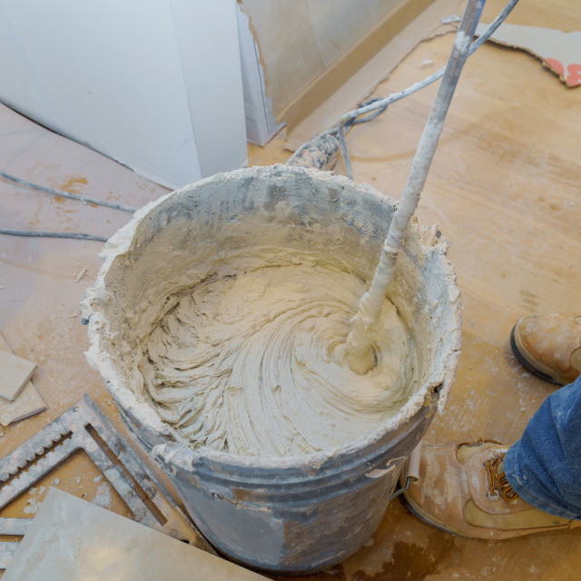 """""""Mixing Tile adhesive or cement with a power drill"""" stock image"""