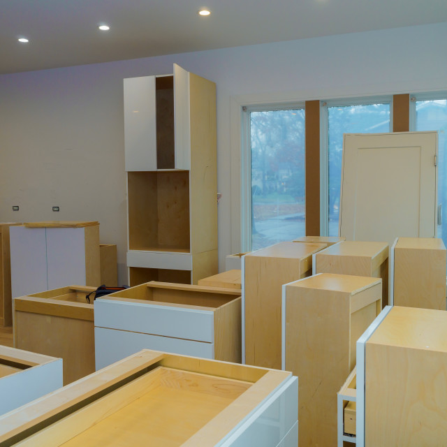 """""""Custom kitchen cabinets in various stages of installation base for island in..."""" stock image"""