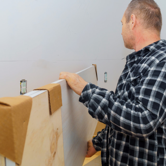 """""""Contractor installing a new laminate kitchen counter top"""" stock image"""