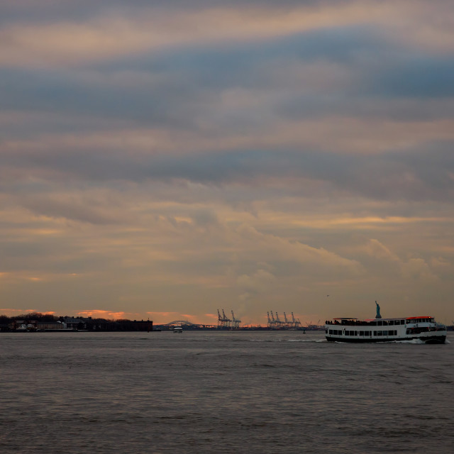 """""""Container cranes in New York harbour at sunset and Statue of Liberty"""" stock image"""