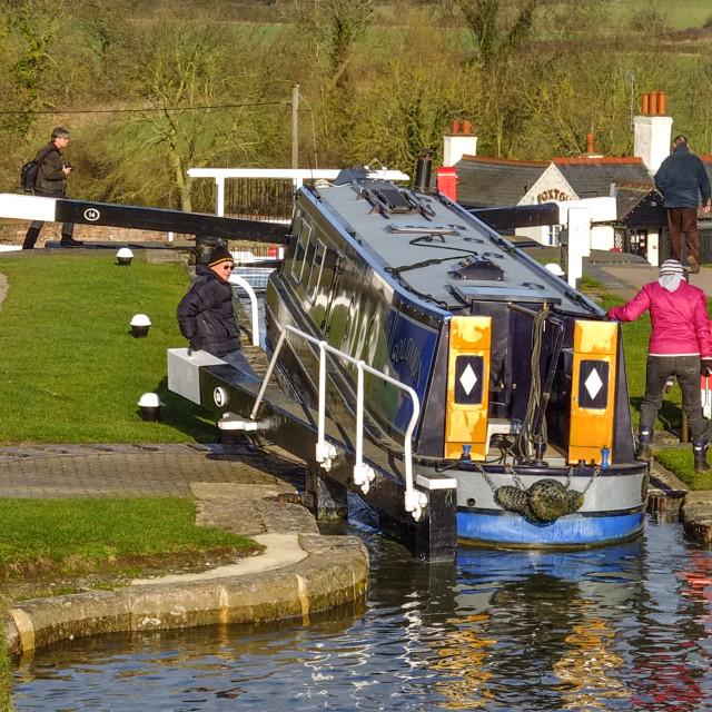 """Narrowboat entering a canal lock"" stock image"